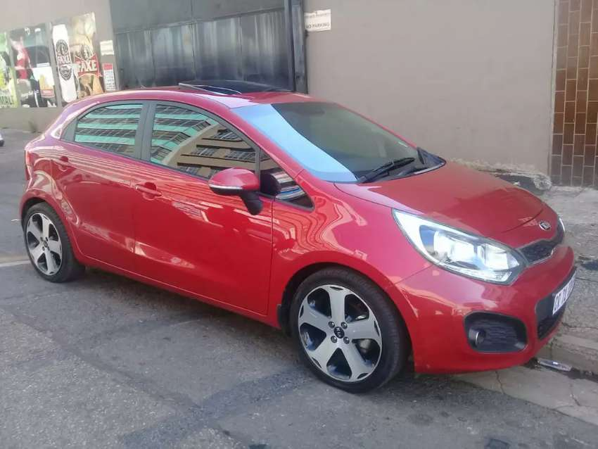 Red kia rio for sale 2015 model at low price hatchback 0