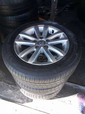 A set of 185/60/14 Polo tsi tyres and mag