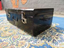 Black metal travel trunk
