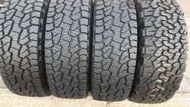 A set of 31x10.5x15 1xbfgoodrich and 3 by hankook