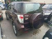 Toyota Rush KCP number maroon colour 0