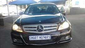 Pre -Owned  Black Mercedes Benz c180  AUTO