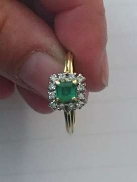 Beautiful emerald and diamond ring gold band
