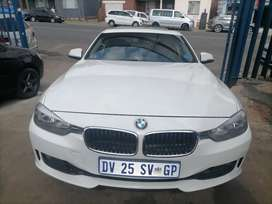 2014 BMW F30 320i with a leather seat and sunroof