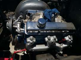 Chevy/Studebaker 283 v8 and Powerglide gearbox.