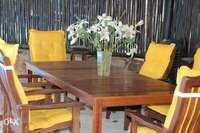 Image of Wooden table and chairs with cushions