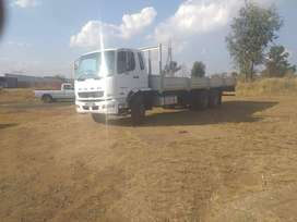 Fuso FN25 270 with drop sides and tag axle