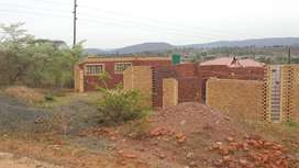 Stand for sale with unfinished house at Tshilamba