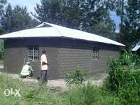 A 1/2an acre on sell mumias with a permanent house 0