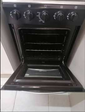 Black and silver gas stove includes oven