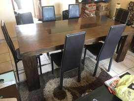 Dark brown wooden dinner table with 6 chairs