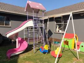 Jungle gym with slide and swings including kids house and wurm.