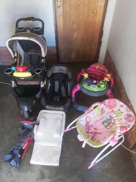 Baby carrier,Jeep Straller,Rocker chair ,car seat and a snuggle bed