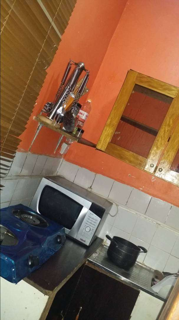 Self contain with a well furnished kitchen and toilets 0