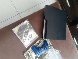 Playstation 3 with 1 controller and 3 games inside 1 game case