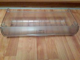 Прозрачный ящик холодильника для овощей , рыбы .