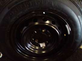"""16"""" Toyota Hilux steel rim for a sparew wheel with a used tyre"""