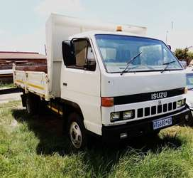 Isuzu N4000 4cube tipper with dropsides for sale