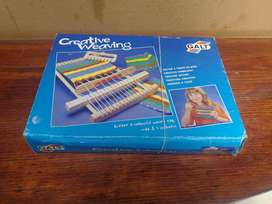 Awesome old, new childs weaving loom.