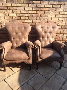 Pair of wing back arm chairs