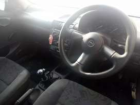 2006 Corsa lite with a red roof, costs R25K when including red mags