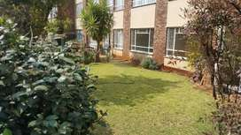 specious 2-bedroom with garden view. Potchefstroom lungile apartments)