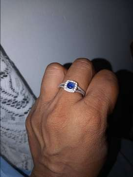 White gold 9c ring with diamonds and blue stone. R5000 onco