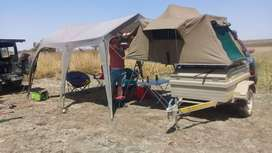 Camping trailer rooftop tent