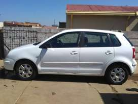 Its a white hatchback body type polo 2004 model.