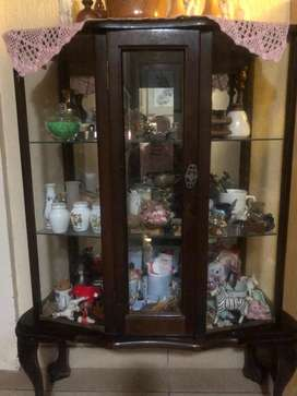 Antique imbuia ball and claw showcase.