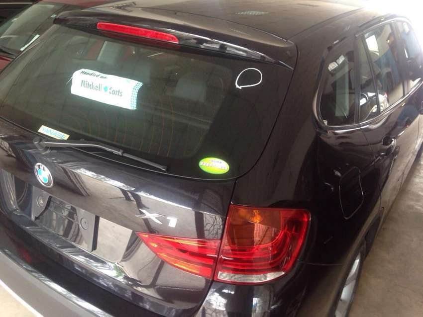 Five seater BMW X1 with leather seats and sunroof and tinted panes 0