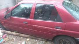 It's a red Ford escort sedan..4 door.everything in working condition