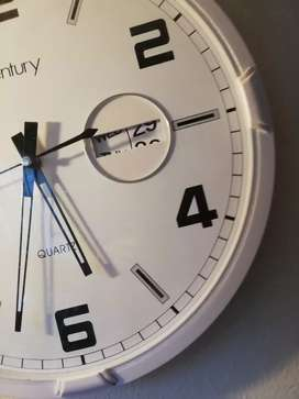 Clock with date and month for sale