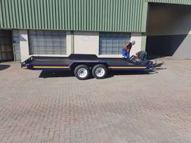 The Double Axle Flat Bed Tilt Car Trailer