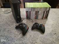 Image of Xbox 360, remotes and games