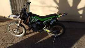 Kawasaki 250 kx and two smaller dirt bikes