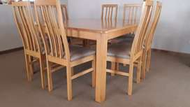 8 seater solid oak dining room table and chairs