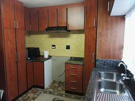 Built in cupboards with granite
