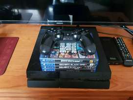 PS4 500GB PLUS 1 REMOTE AN 5 GAMES
