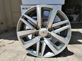 "Good as new Toyota Fortuner 18"" original mags."