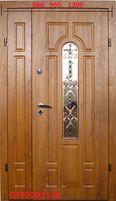 Двері в приватний будинок з ковкою