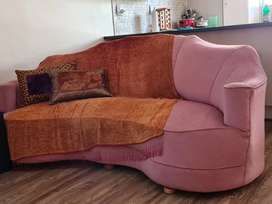 Beautiful pink couch with accessories