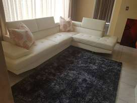 L shaped lounge suite combo( couch,cushions and carpet)