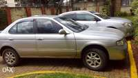 Clean silver Nissan for familu use,low mileage 370k 0