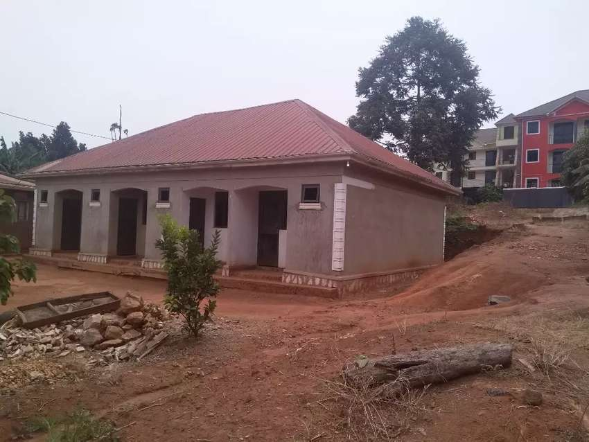 Land and a semi-finished 4units rentals up for sale at kyaliwajalla 0