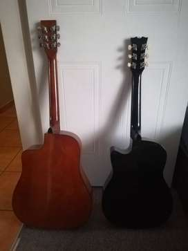 Black guitar is a SANCHEN and the brown is a RITMIILLER