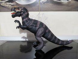 Динозавр.Ходит,звук,свет,подвижные челюсти