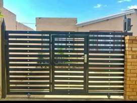 GALVANIZED STEEL FRAMED NUTEC GATES AND FENCING