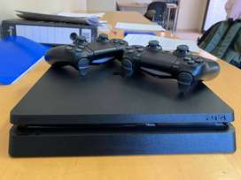 Ps4 pro 1tb  2 v2 controllers and 4 games