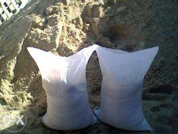 Песок ,щебень 50кг/меш , самосвальные нормы.
